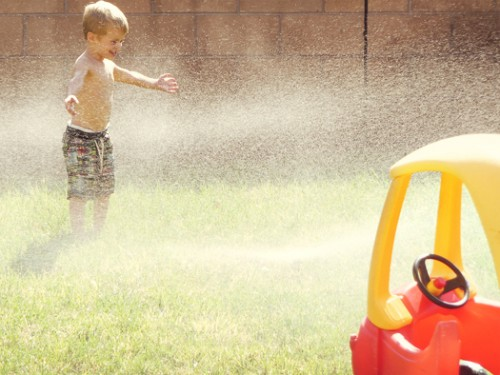 playing in sprinklers