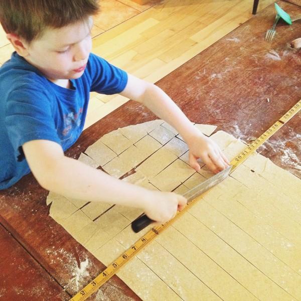 Noah cutting crackers | Simple Bites #kidsinthekitchen