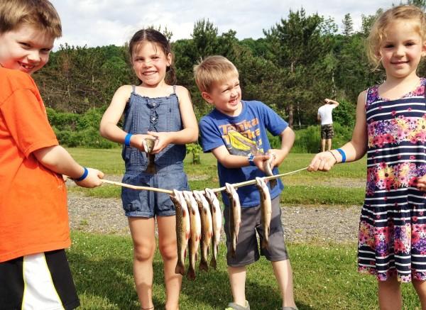 kids with fresh caught fish
