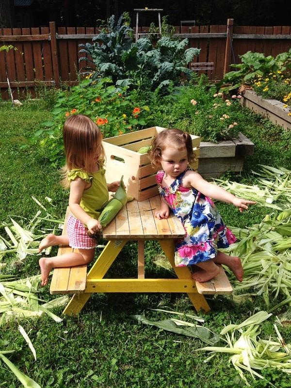 girls shucking corn